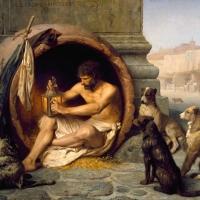 """Na Academia, depois que Platão chegou a definir o homem como """"um bípede sem plumas"""", Diógenes acorreu com uma galinha depenada, bradando: """"Eis o homem de Platão! Eis o homem de Platão!"""""""