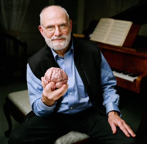 In this 2007 photo provided by the BBC, Neurologist Oliver Sacks poses at a piano while holding a model of a brain at the Chemistry Auditorium, University College London in London. Noted neurologist Oliver Sacks has found common ground with the pastor of Harlem's Abyssinian Baptist Church: Both men believe in the healing power of music. Sacks, the best-selling author of