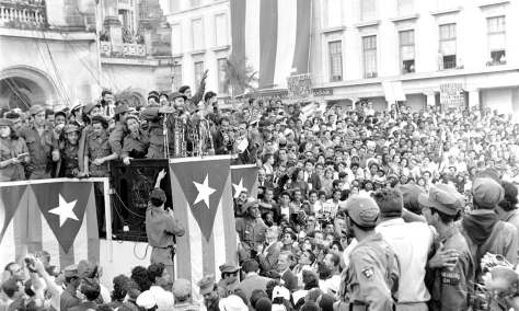 FILE - In this Jan. 1959 file photo, Cuba's leader Fidel Castro addresses a crowd in a park in front of the presidential palace in Havana, Cuba. Former President Fidel Castro, who led a rebel army to improbable victory in Cuba, embraced Soviet-style communism and defied the power of 10 U.S. presidents during his half century rule, has died at age 90. The bearded revolutionary, who survived a crippling U.S. trade embargo as well as dozens, possibly hundreds, of assassination plots, died eight years after ill health forced him to formally hand power over to his younger brother Raul, who announced his death late Friday, Nov. 25, 2016, on state television (AP Photo/Harold Valentine, File)